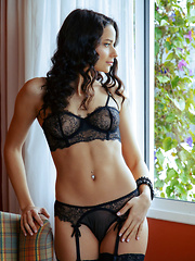 Ardelia A sensually strips her sexy lingerie on the couch.