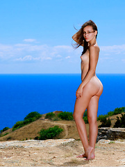 Belonika strips her sexy swimsuit as she bares her curvy hips and slender body.