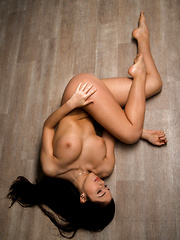 Diana Dulce strips her sexy lingerie baring her delectable body on the floor.