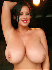 Sarah's sizzling smile, charismatic beauty and perfectly shaped H-cup big boobs have made her nothing less than an absolute smash hit and now she is back once again in another fantastic photo set, showing off her incredible frame and amazing beauty.